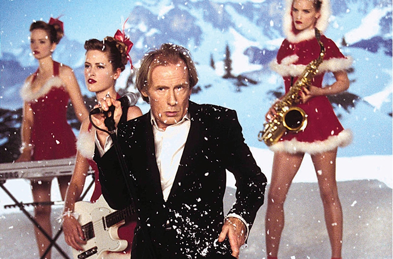Bill Nighy as Billy Mack in Love Actually, performing Christmas is All Around
